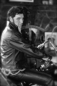 Vancouver Elvis Impersonator, Ronnie Scott, on a motorcycle