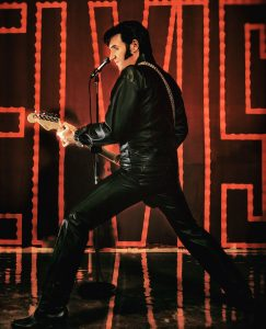 Elvis Impersonator with guitar